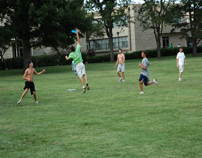 Students playing frisbee on the union lawn-8