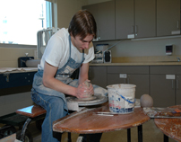 Student working on potters wheel-9