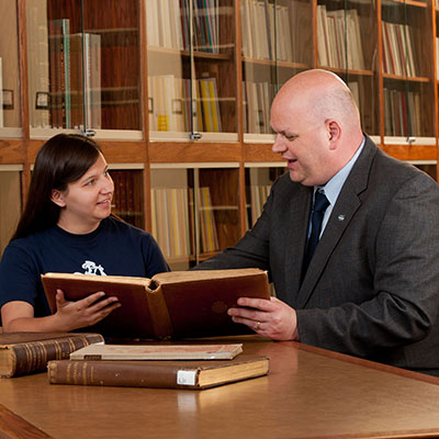 A Washburn student works with dean of libraries and history professor Alan Bearman.