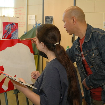 Student and professor painting