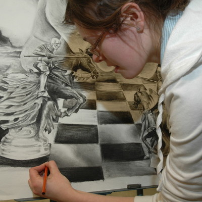 Student drawing a chessboard with other images
