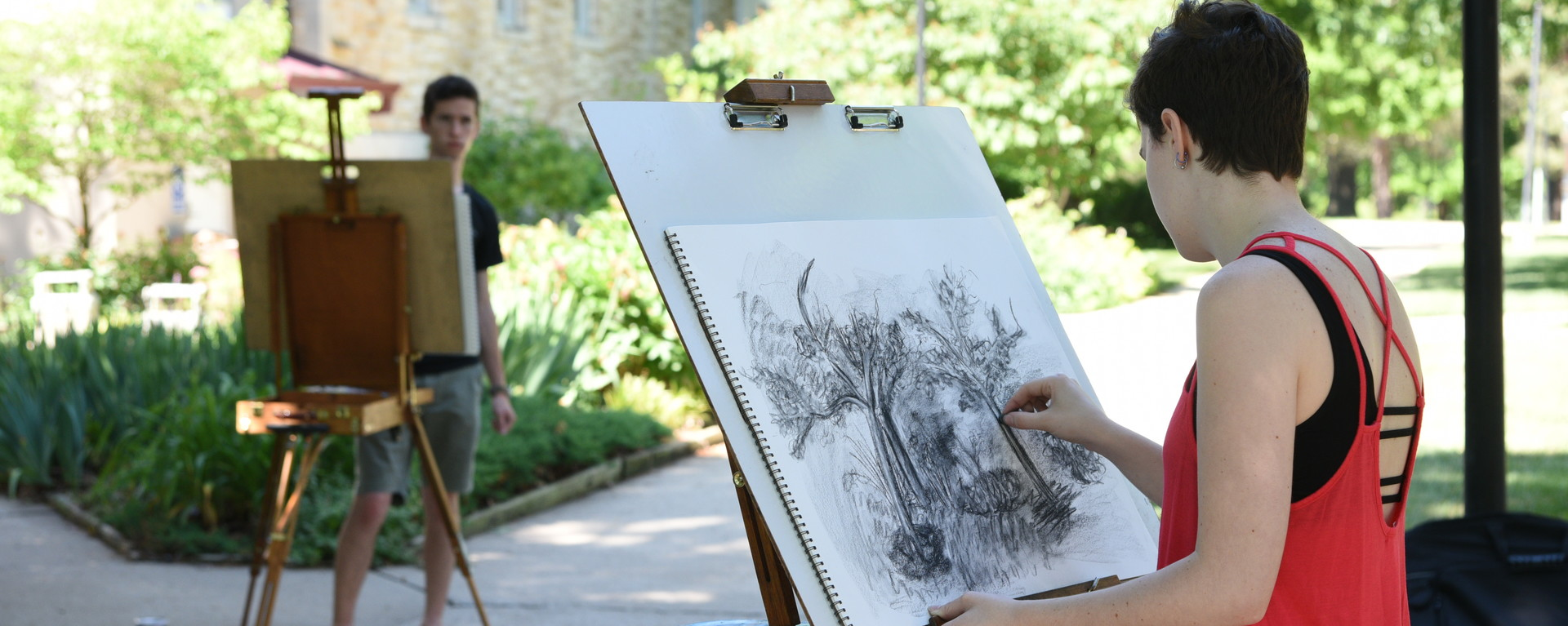 Students drawing outside on campus