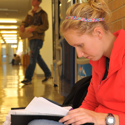 student studying in hallway