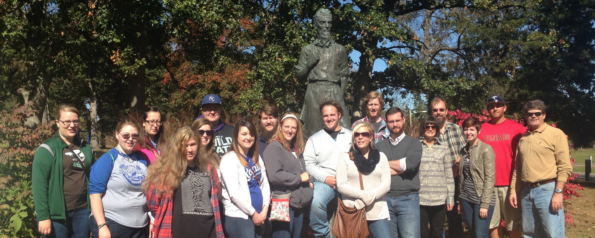 History department students and faculty with statue on trip