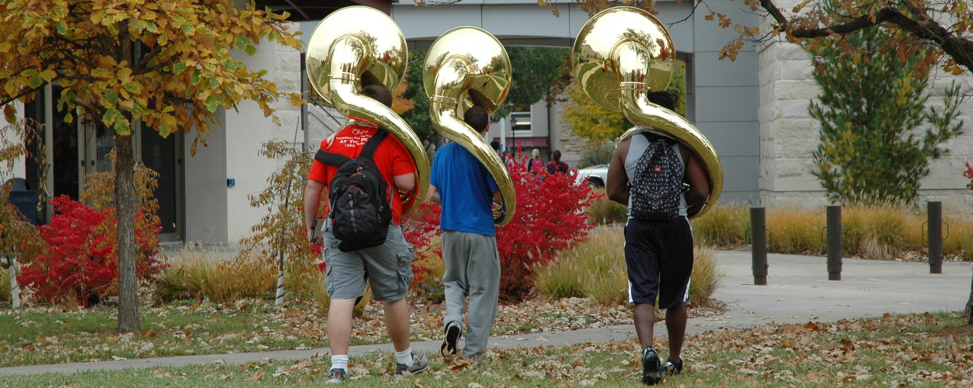Students Walking with Tubas