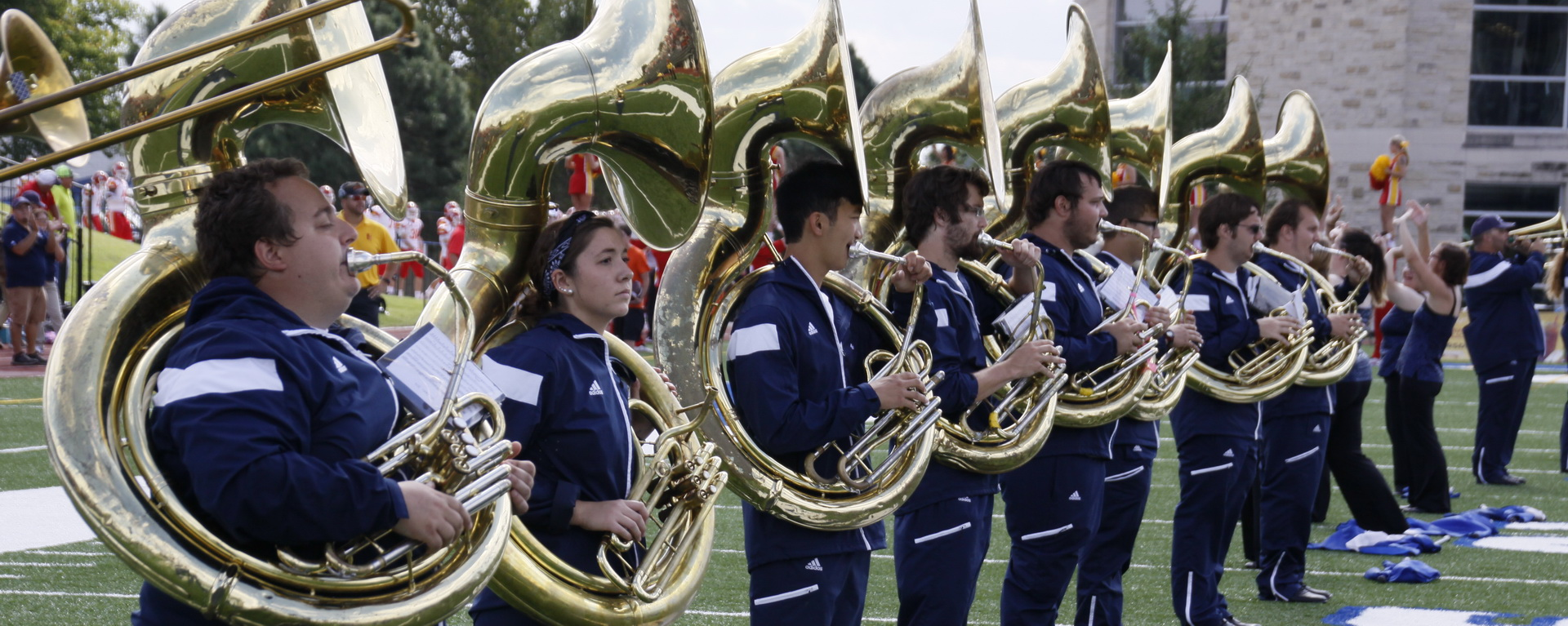 Marching Blues tuba players on football field