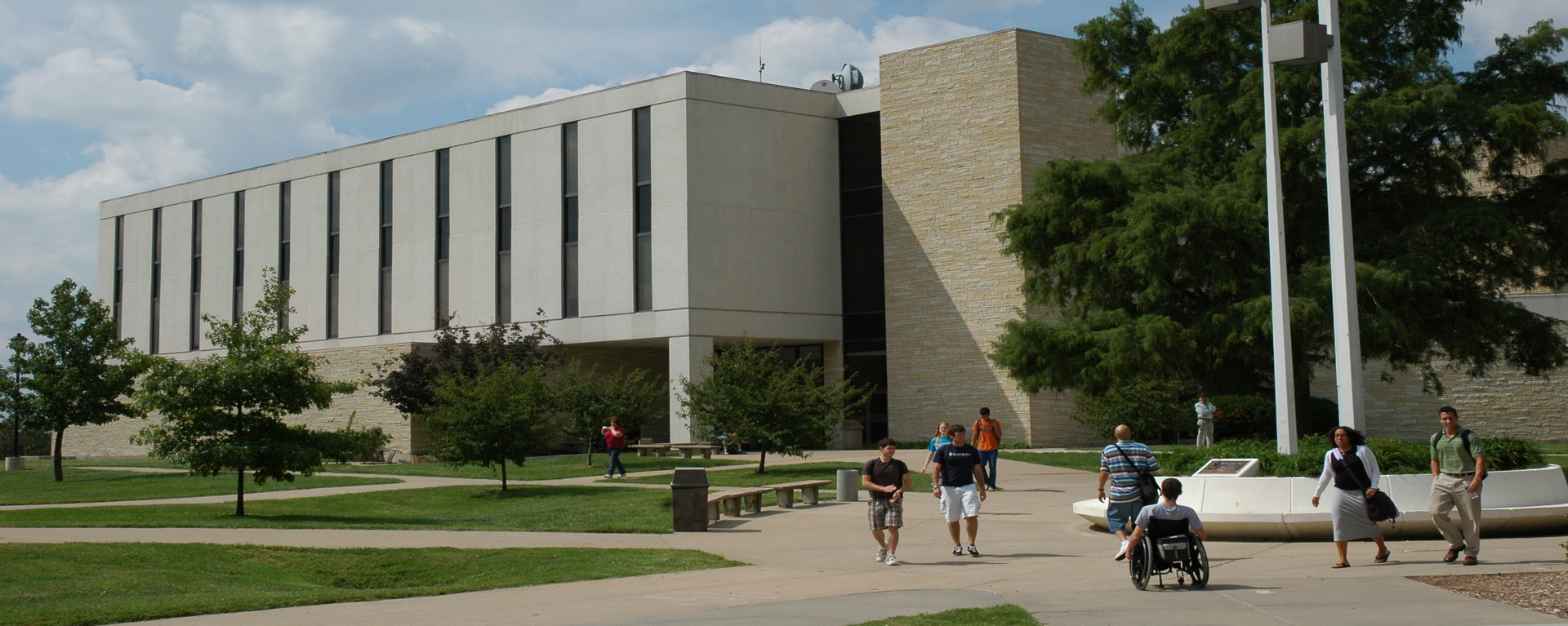 Picture of Henderson building with people walking around outside.
