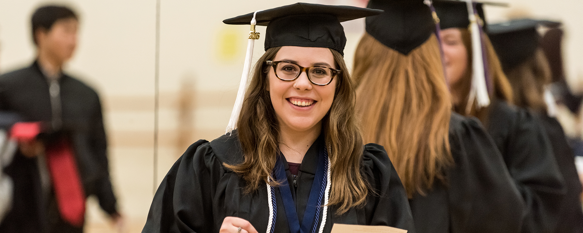 A Washburn student prepares for the graduation ceremony at Lee Arena in 2016.