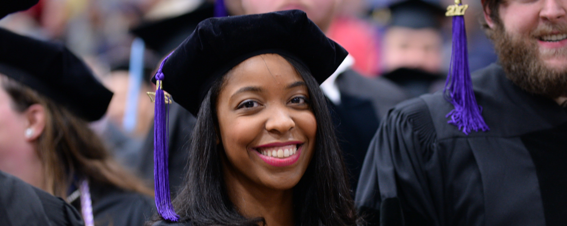 female student at graduation and smiling