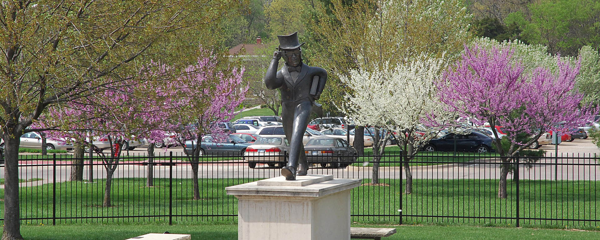 Ichabod statue on campus with spring trees