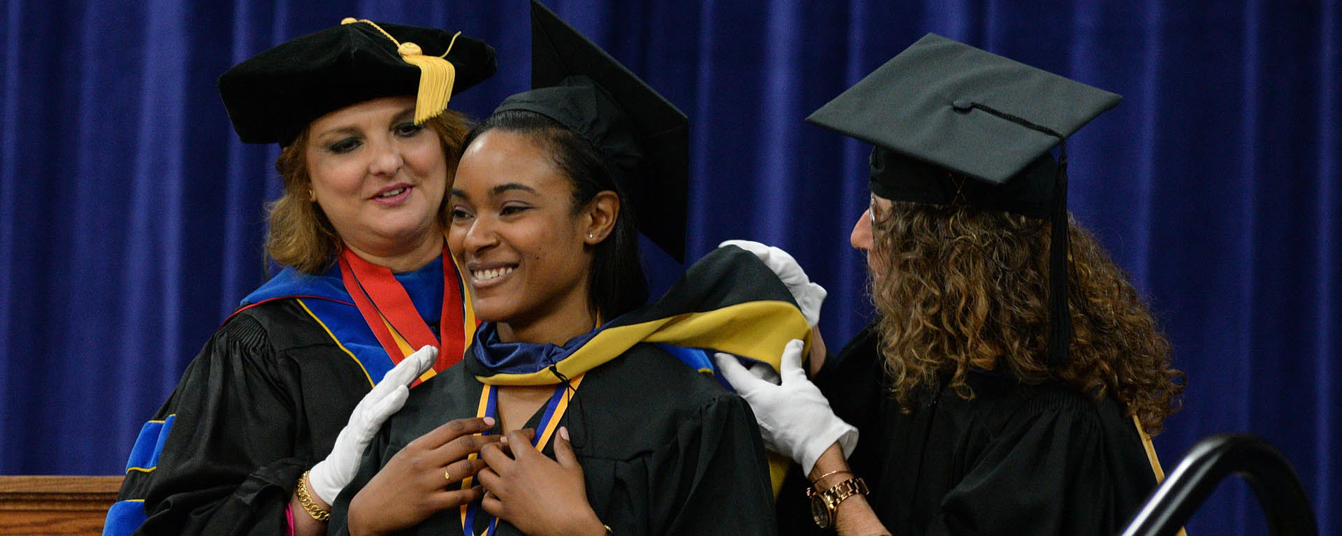 Graduating female student smiling