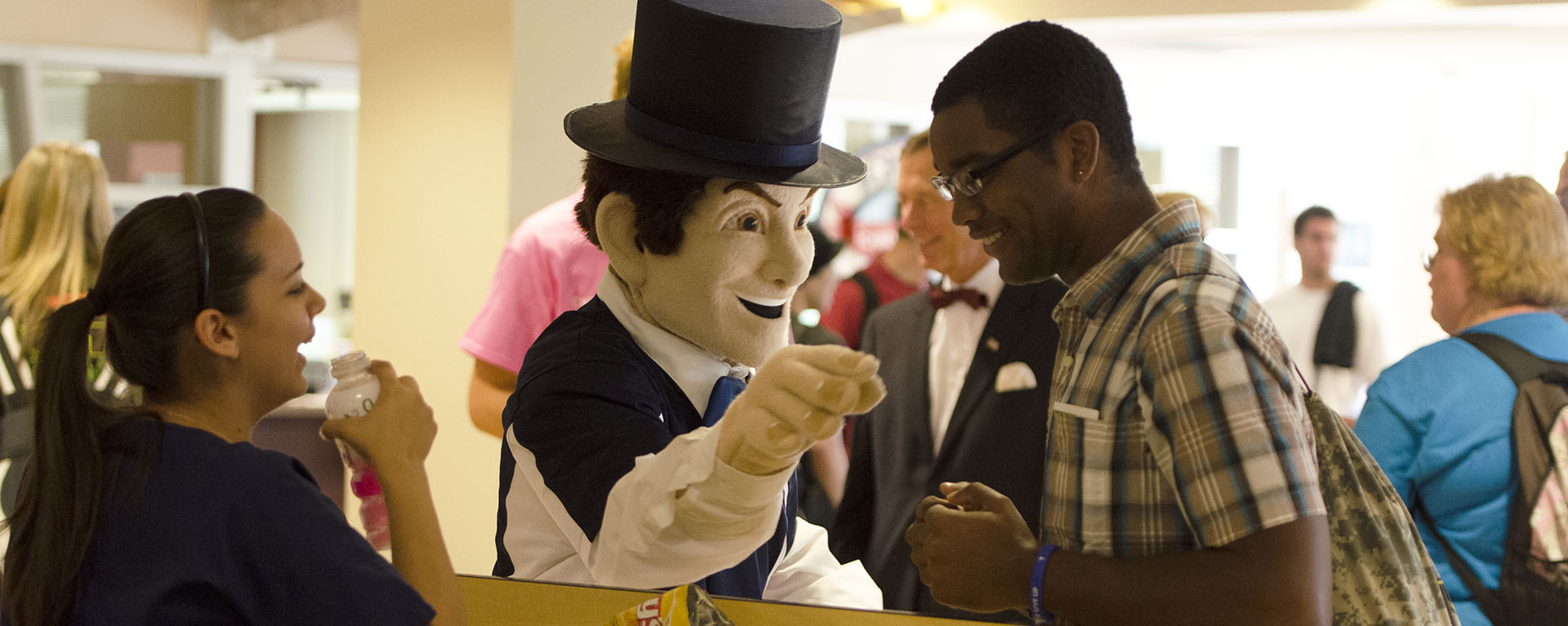 Ichabod mascot with students inside the Union