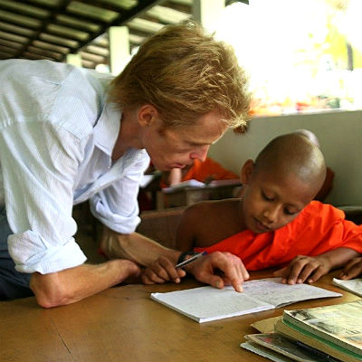 man teaching a young boy