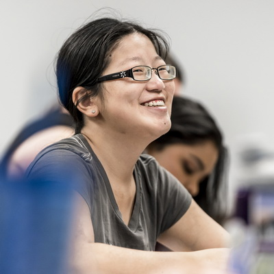 Asian girl smiling in class