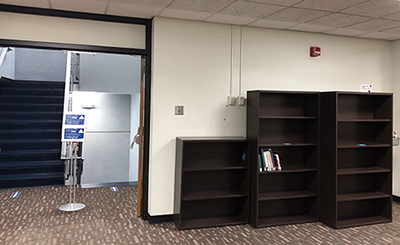 photo of shelves in Mabee Library next to the main stairwell