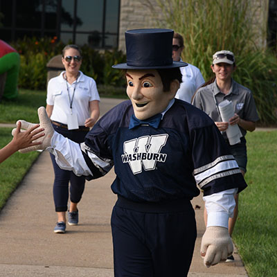 Ichabod mascot gives high five