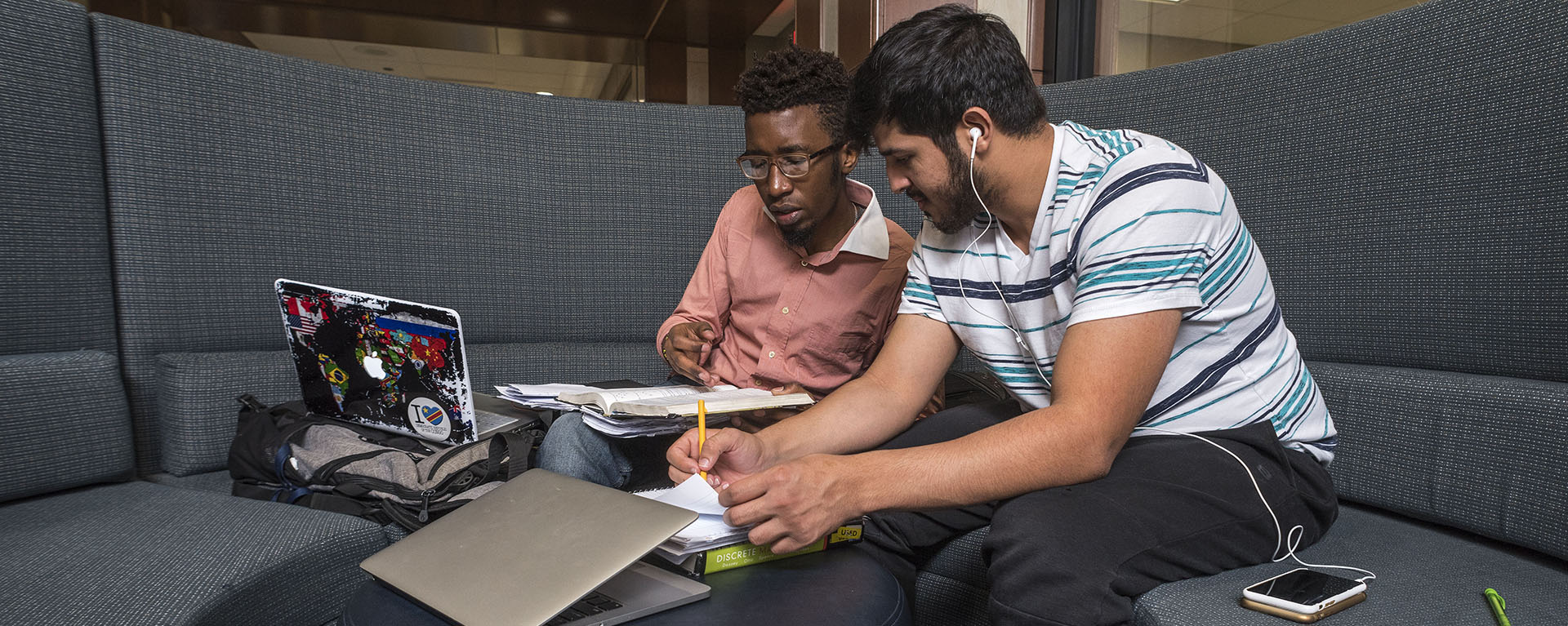 Two international students work on a project in the Morgan Hall Welcome Center.